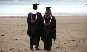 A Male and female graduate
